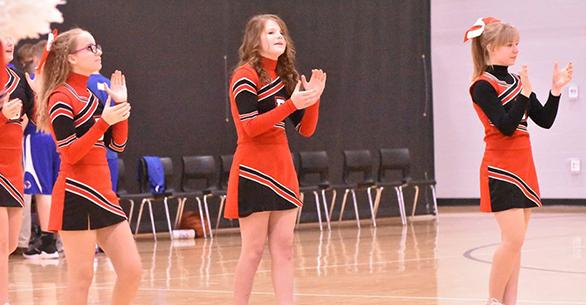 Cheerleaders in gymnasium
