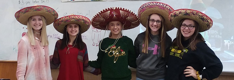 five students wearing sombreros