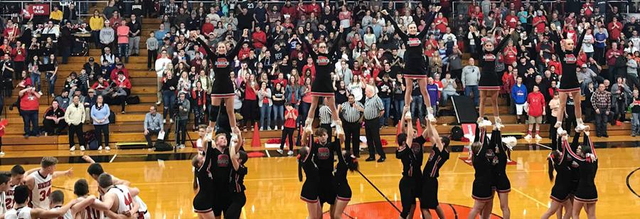 Basketball players and cheerleaders at basketball game
