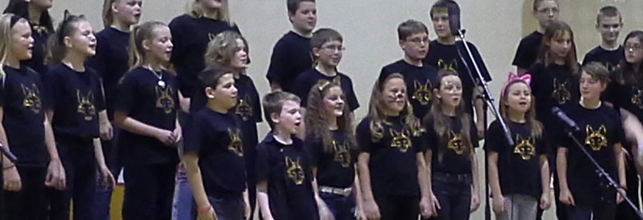 Group of students singing during a performance
