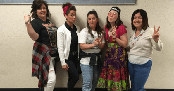 Staff members dressed in outfits from different time periods pose together