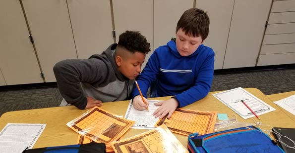 Two students working on a class assignment together