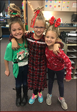 Students dressed up in Whoville and Grinch Christmas attire