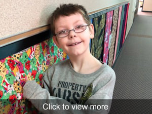 View more photos of students using the sensory wall