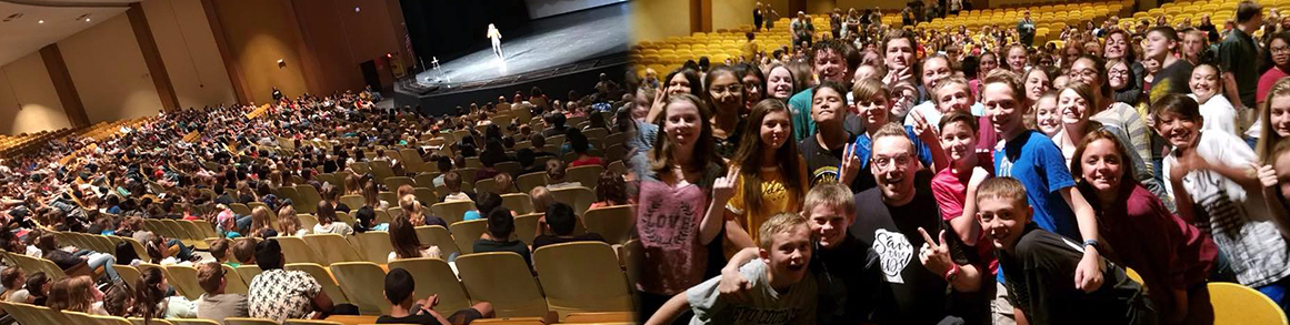Students watch a performer in the auditorium and then pose with the performer