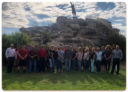Heber-Overgaard Unified School District Number 6 staff members pose outside together