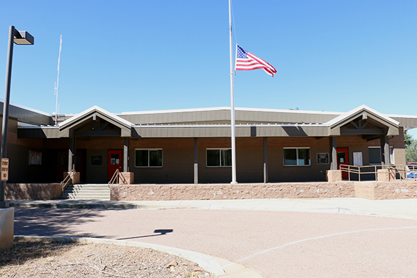 Main building with flag at half mast
