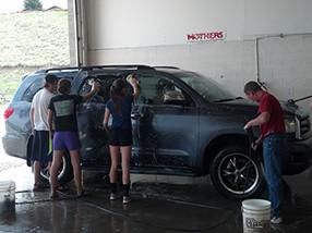 Students wash a car
