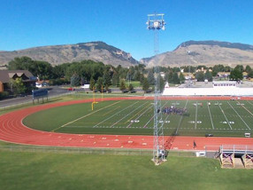 Side view of a sports field and mountains