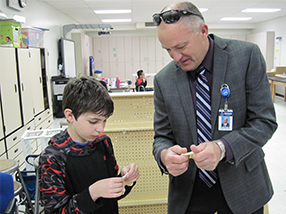 Superintendent Ray Schulte stands with a student