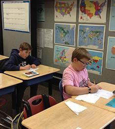 Boys working at their desks