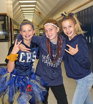 Three girls dressed in school colors
