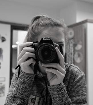 A girl taking a photograph with her camera