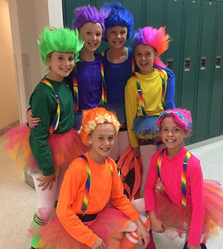 Six students dressed as trolls pose in front of lockers