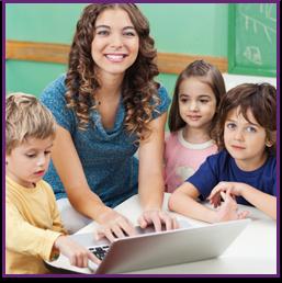Teacher helps students use a laptop