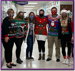Staff members in ugly sweaters