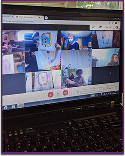 View of a laptop screen with a group of students and a teacher in a virtual class