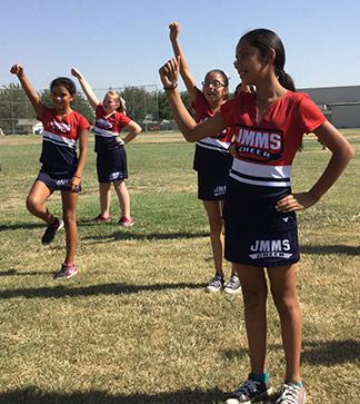 Cheerleaders cheer outside