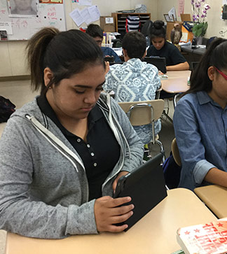 Students use tablets in class