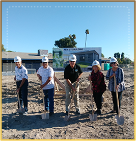 Corcoran USD admin team with shovels at construction site