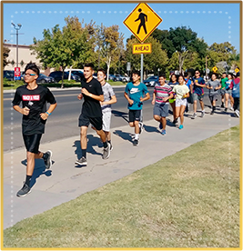 Students running in an outside event