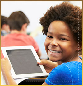 Smiling student holds computer tablet