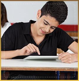 Student presses finger on tablet