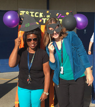 Two teachers with props for Halloween