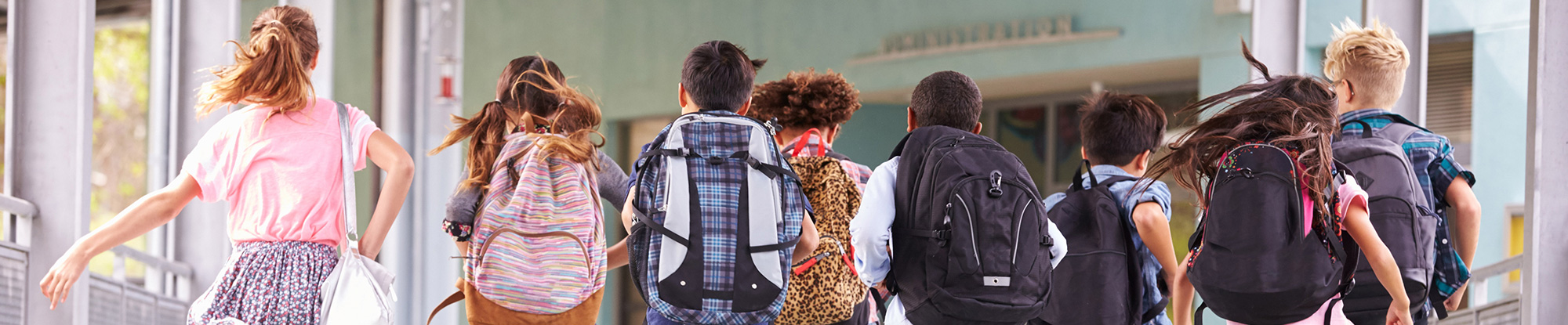 Students with backpacks running