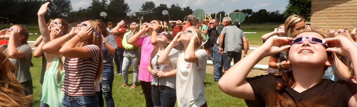 girls viewing eclipse