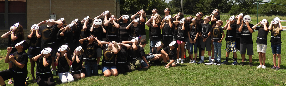 students viewing eclipse with special masks