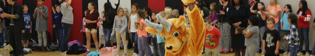 School mascot antelope waves in front of a group of students