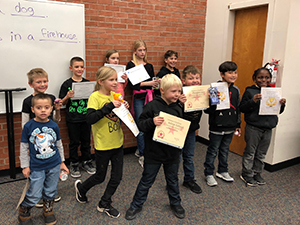 Elementary students of the month holding their certificates