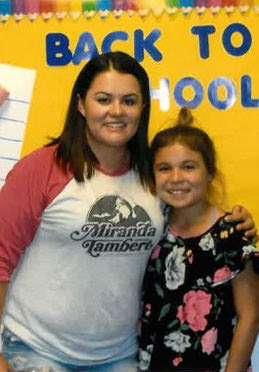 Mother and daughter attending Back to School Night