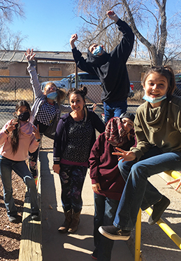 Eighth grade students showing their silly side outside