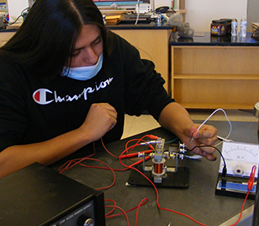 student working with a motor