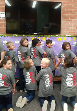 2nd and 3rd grade wearing one town, one school, one family t-shirts