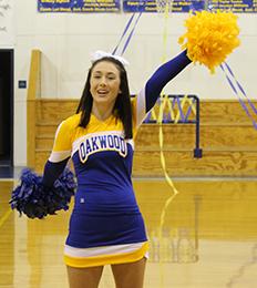 Cheerleader holding pom poms