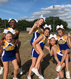 Cheerleaders pose together