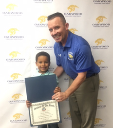 Dr. Lee with elementary school student of the month for October