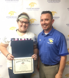 Dr. Lee with the high school student of the month for October