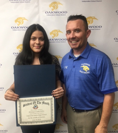 Dr. Lee with junior high student of the month for October