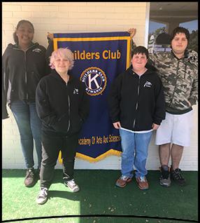 Builders Club members pose together