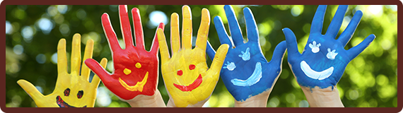 Five hands painted with colorful smiley faces