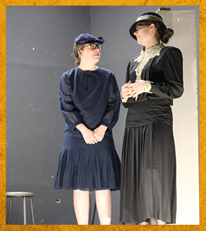 two female students in costumes
