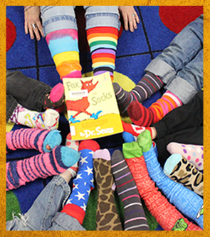students with colorful socks with the book Fox for Socks