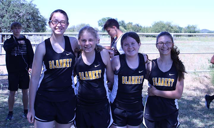 four happy girls on the cross country team