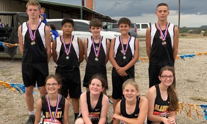 Cross country athletes wearing medals
