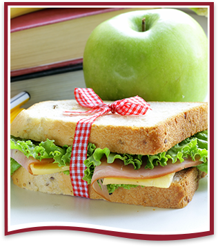 Sandwich, apple and stacked books