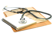 Clipboard, needle, notebook and a stethoscope